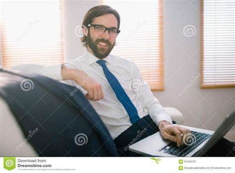 laptop on couch businessman using laptop on the couch stock photo image