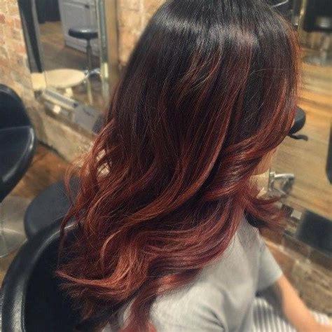 mahogany red hair with high lights it s all the rage mahogany hair color auburn balayage