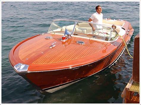italian boat 1973 italian riva aquarama wooden speed boat by the dock
