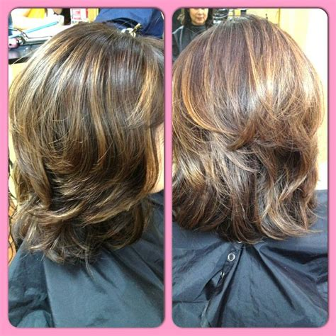 layered haircuts with highlights in crown area shoulder length hair cut with short round layers