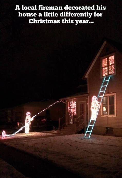 a fireman s christmas light decoration holiday light