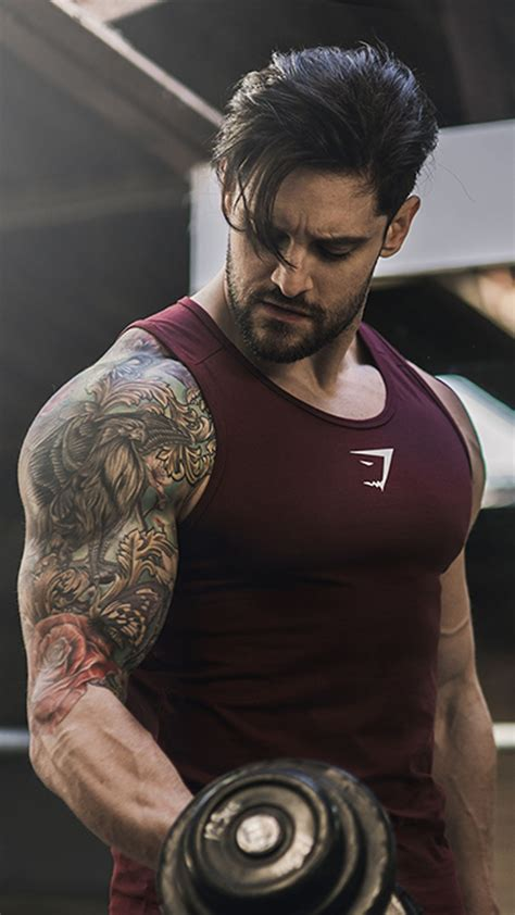 workout tattoos it s all about results lifting weights in the