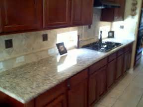 kitchen counter and backsplash with granite top