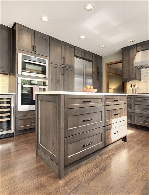 grey stained cabinets like the lighter grey 2nd but the flat drawer profile of the 3rd kitchen light green kitchen cabinets gray stain grey and