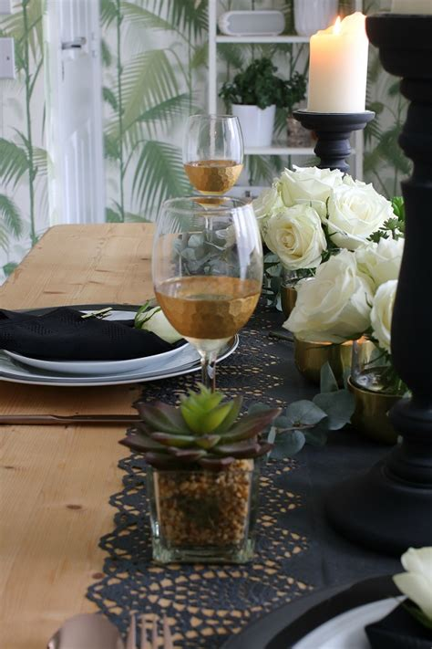black and gold table setting a black and gold table setting for a special dinner