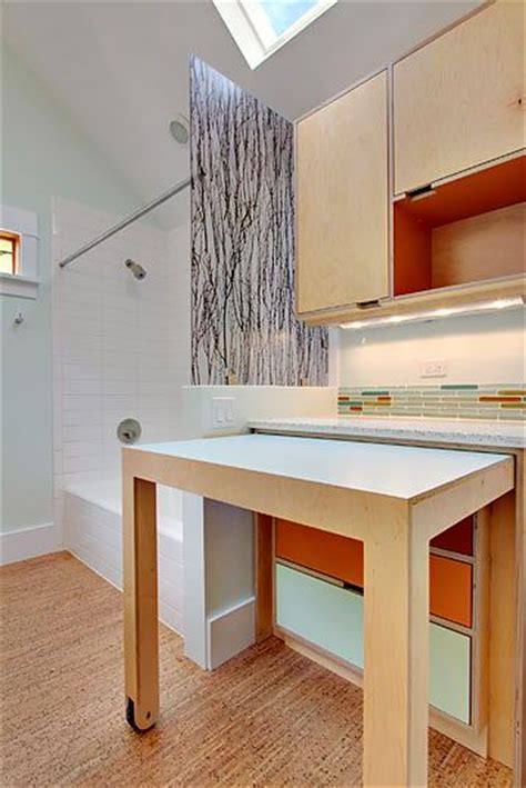 pull out table between washer and dryer laundry station next to a washer and dryer with pull out