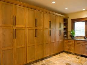 wall to wall kitchen cabinets laundry room with custom wall to wall cabinets hgtv