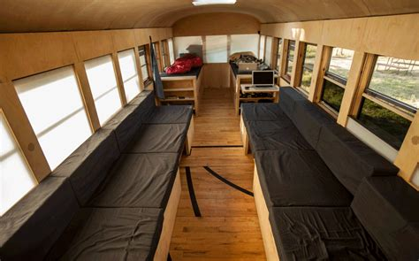 tiny house seating school bus converted into small home by architecture student