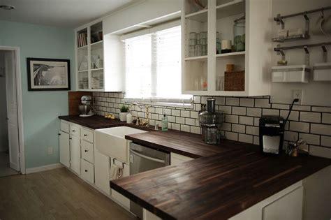 Dark wood countertops, white cabinets   Kitchen