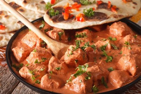 Indian Tikka Masala 50gr By Asian Home Gourmet indian food chicken tikka masala and naan up on the