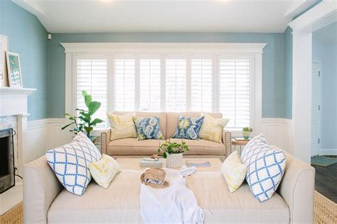 beige and blue living room with wainscoting transitional living room