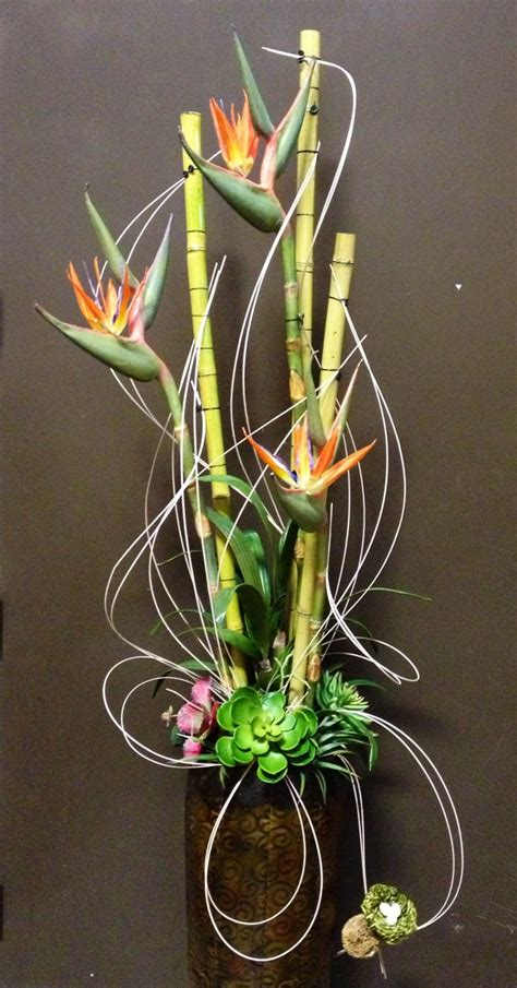 bird of paradise arrangement designed by arcadia floral bird of paradise with bamboo poles for tall arrangement