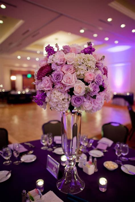 Tall centerpiece with white purple and pink flowers   My