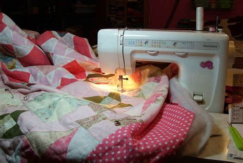 how to pin baste a quilt on a table how to baste a quilt with safety pins