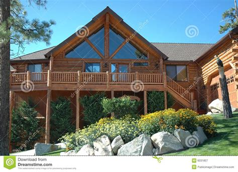 Cabin Style Home Log Cabin Home Interior With Warm Fireplace With Wood Flames A Royalty Free Stock Image