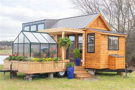 tiny homs tiny house comes with a greenhouse and porch curbed