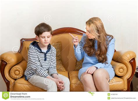 mom son couch mother scolds son stock photo image 41353791