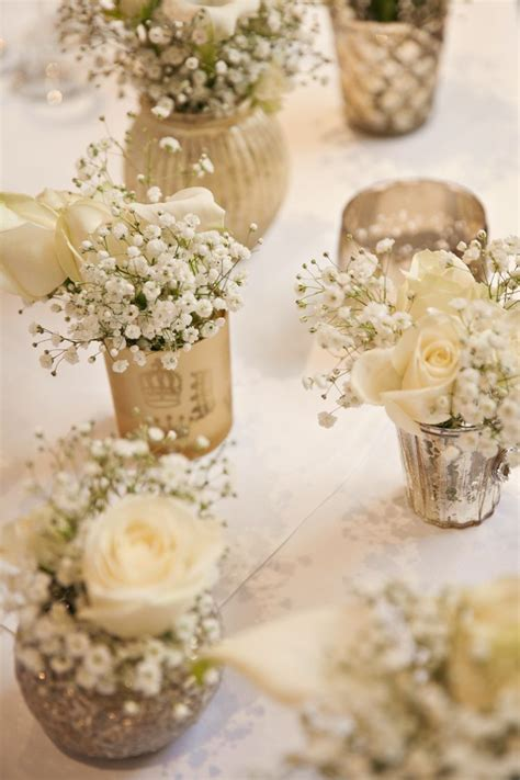 gold table centerpieces gold votives white flowers baby breath gypsohila tables