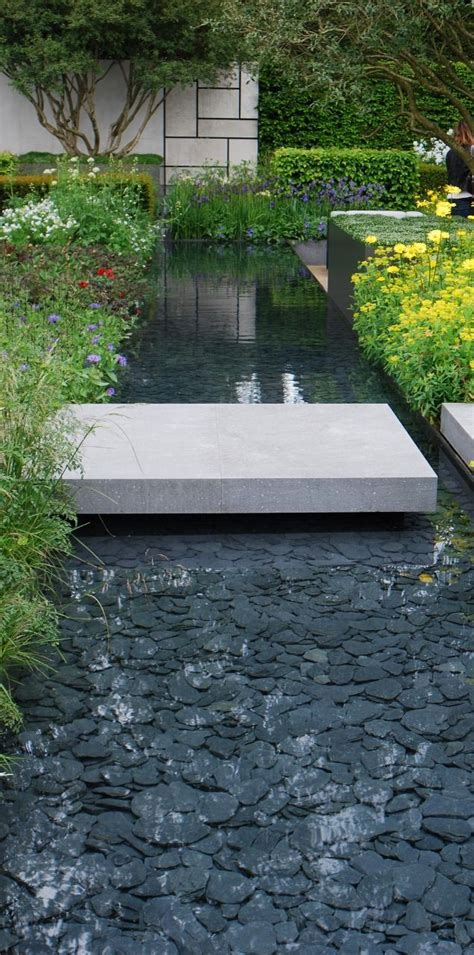 modern water feature slate paddlestones in contemporary water feature at rhs