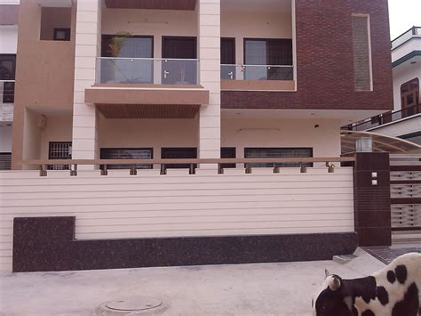 Main Door Designs For Indian Homes by Front House Boundary Walls With Grooves Gharexpert
