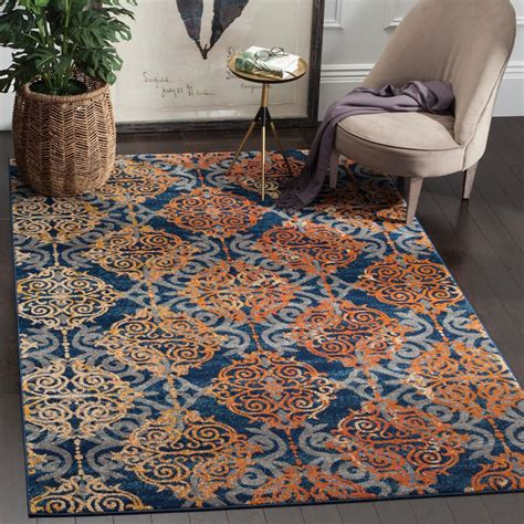 Orange And Blue Area Rugs Safavieh Evoke Blue Orange 6 Ft 7 In X 9 Ft Area Rug Evk230s 6 The Home Depot