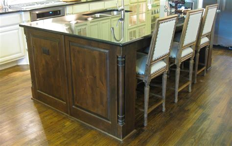 kitchen island with posts kitchen island burrows cabinets central builder direct custom cabinets