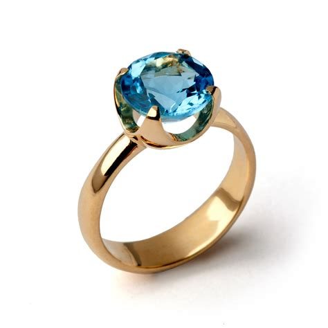 heavenly blue tones of topaz for engagement rings