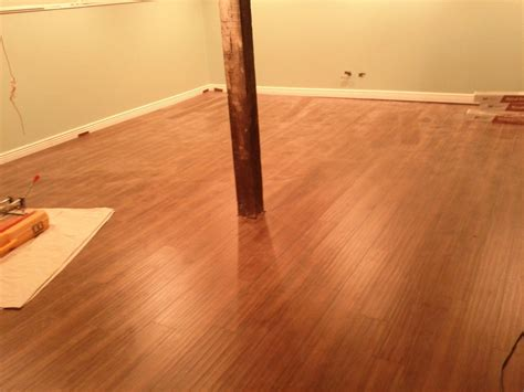 vinyl tile on concrete basement floor laminate flooring basement laminate flooring