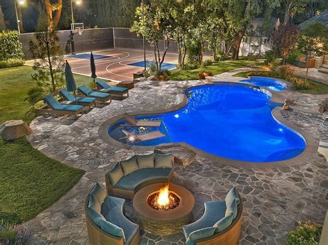 with a fire pit the backyard is perfect for entertaining