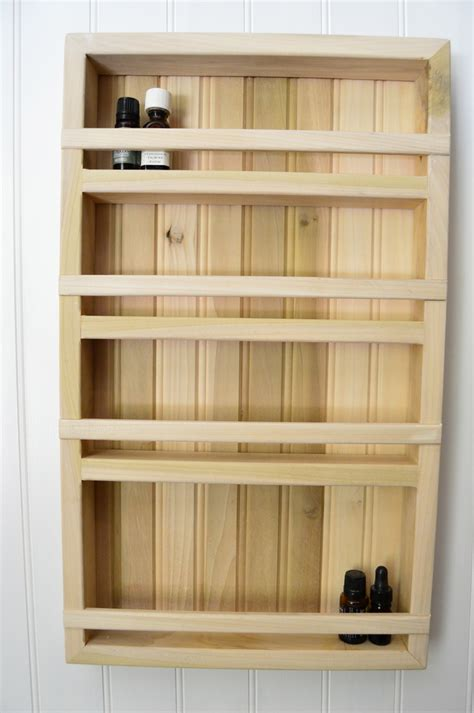 essential oil storage cabinet wall mounted wood essential oil display by pierce
