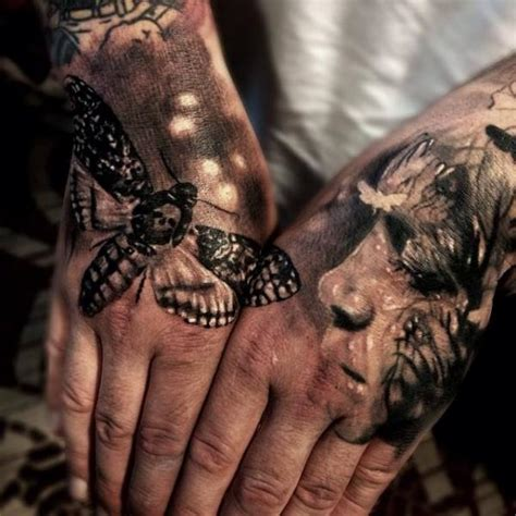 tattoo hand back back of the hand moth and face tattoo by jak connolly