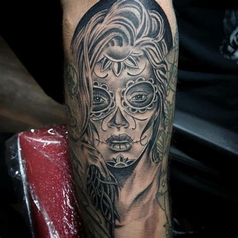 70 Eye Catching Day Of The Dead Tattoos Faces Skulls Daring Images Of Day Of The Dead Tattoos
