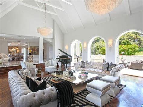 4 glamorous interior design tips to look for glamorous living room gray tufted sofas impressive
