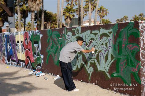 spray painting on walls photo graffiti artist venice california usa