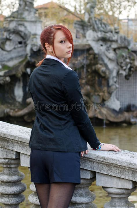 stone banister elegant red head girl outdoors against stone banister stock photography image 35504292