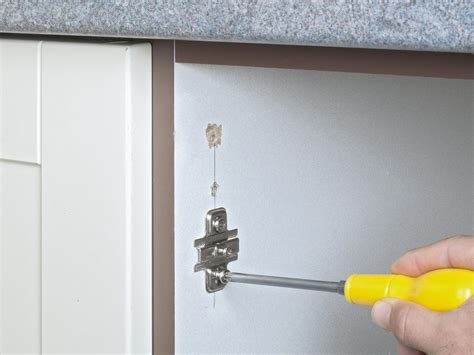 how to repair kitchen cabinet hinges how to fix kitchen cabinet door hinges bar cabinet