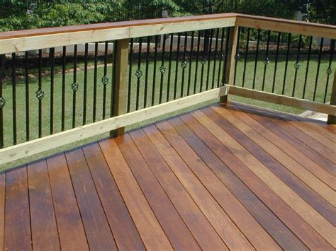 Metal Porch Pickets Ipe Deck In Fortsyth Ga With Wooden Rail And Metal Pickets