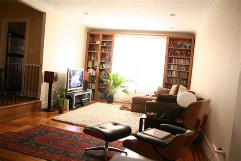 where to put tv in living room with lots of windows how to decorate around your flat screen television