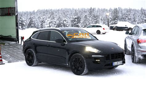 porsche snow porsche macan baby cayenne spied in the snow photos 1