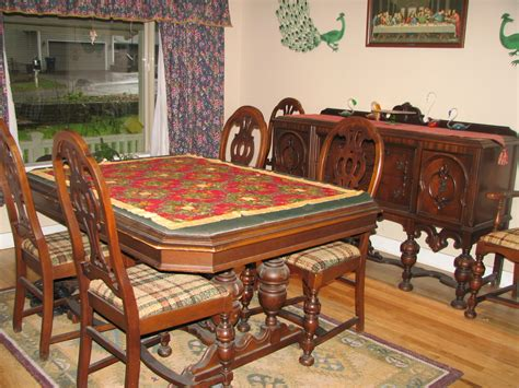 antique dinning room set has 6 chairs buffet and a table