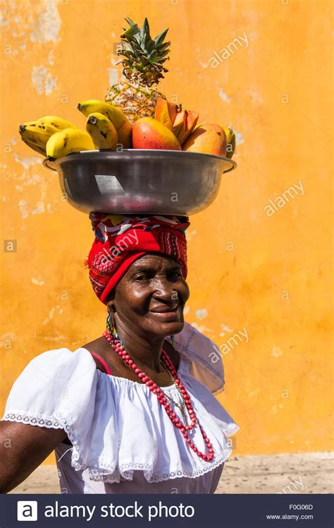 woman with fruit basket on head portrait of palenquera carrying basket of fruit on her