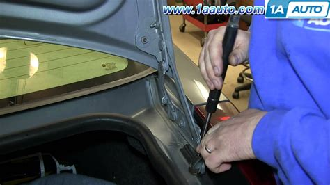 how to install replace trunk lid support strut buick how to install replace sagging trunk lid lift support strut 2003 10 cadillac cts youtube