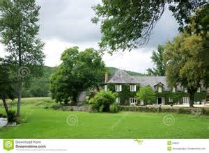 House in country garden behind trees stock photos image
