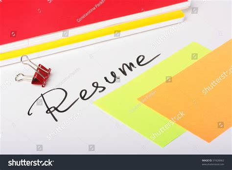 on a white background an inscription resume with two thick writing books and paper for