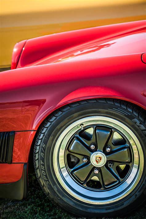porsche wheel emblem 1984 porsche 911 wheel emblem 2270bw photograph