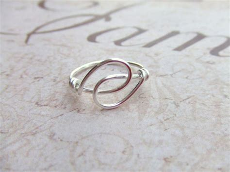 holding friendship ring wire wrapped ring silver