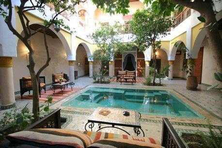 house plans with courtyard pools big or go home indoor courtyard with pool and arched doorways or a koi pond t