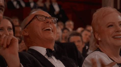 Rolling On The Floor Laughing Gif by Michael Keaton Laughing Gif Find On Giphy