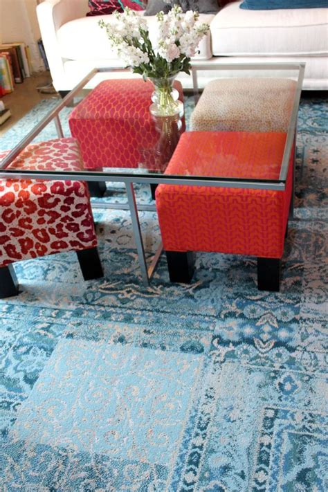 extra seating small living room small footstool under glass table colorful ottomans under a glass table day by day
