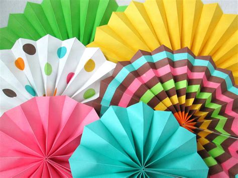 How To Make Hanging Paper Fans - hanging paper fans rosettes and hanging pinwheels